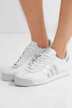 e8e326c819d5 Rubber sole measures approximately 20mm  1 inch White and silver leather  Lace-up front