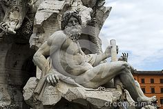 Details of a stone sculpture in the fountain at the Piazza Navone, Rome, Italy.