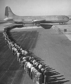 400 Passengers Waiting to Board the XC-99 | Allan Gran