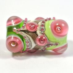 Green, Pink and Gold Lampwork Focal Glass Bead by catlampwork on Etsy https://www.etsy.com/listing/170236040/green-pink-and-gold-lampwork-focal-glass