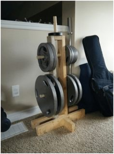 Here at DIY Active, we are all about getting fit at home but many people are worried that costs too much. But never fear! There are several ways you can create your own DIY equipment for almost nothing! Check out this economical DIY weight tree and how it can complement your squat rack! #DIY #DIYGym #fitness #exercise