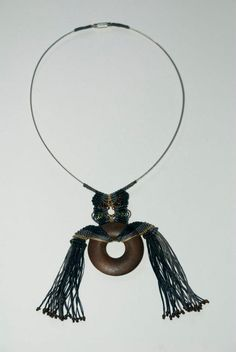 necklace with fine macrame nods, beads and wood circle.