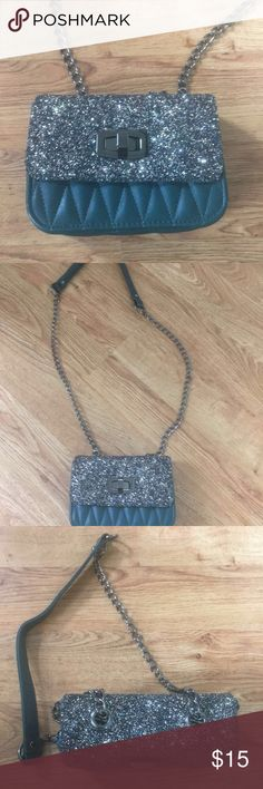 Sparkly green leather clutch From express. Used it twice. In excellent condition. Beautiful clutch can be dressed up or down!! Bags
