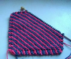 Knitting with cotton dishcloth yarn is a great way to be frugal with your knits - and everyone loves a hand knit dishcloth!    Hand knit dishcloths are machine washable, and can be washed along with your regular laundry.  And this bias knit garter...