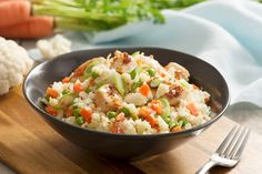 """Make this """"fried rice"""" recipe without rice using cauliflower as the """"rice component."""" This recipe's secret ingredient is sun-dried tomato dressing, adding a bit of zing to tantalize those taste buds. Chicken Fried Cauliflower Rice, Fried Chicken, Vegetable Recipes, Chicken Recipes, Balsamic Glazed Chicken, Cooking Recipes, Healthy Recipes, What's Cooking, Yummy Recipes"""
