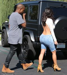 Edgy: The Keeping Up With The Kardashians star teamed the top with ripped denim Bermuda shorts that appeared to have once been jeans before they were slashed at the knee