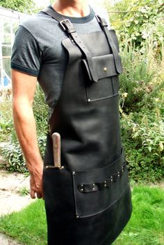 Black Leather Apron with Knife Sheath Pocket - hashtags} Leather Apron, Leather Bag, Black Leather, Shop Apron, Bbq Apron, Knife Sheath, Leather Projects, Leather Crafts, Leather Tooling
