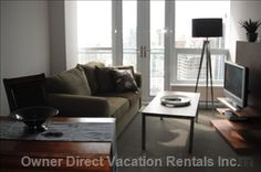 Stylish small living room of a luxury suite in the heart of Vancouver, located in the trendy Yaletown neighbourhood Vancouver Vacation, Downtown Vancouver, Natural Scenery, Vacation Rentals, Small Living, The Neighbourhood, Couch, Living Room, Luxury