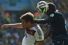 Germany forward Thomas Mueller (left) vies with France defender Mamadou Sakho during the quarterfinal World Cup match at Rio de Janeiro's Maracana Stadium. Germany won, 1-0.