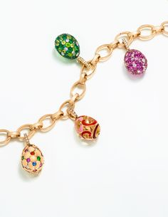 s Egg Charms reference moments in Fabergé's history, including the Treillage egg, left, with its quilted pattern of gold dimpled with precious gemstones, which is a miniature interpretation of the 1892 Imperial Easter Egg. Gemstones For Sale, Green Gemstones, Charm Jewelry, Fine Jewelry, Faberge Jewelry, Rose Gold Charms, Faberge Eggs, Necklace Designs, Jewelry Collection