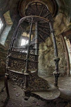 Spiral staircase in abandoned building in Poland.