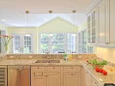 Light Yellow Kitchen Budget kitchen remodeling 10000 to 15000 kitchens kitchen overlooking living room kitchen design ideas pictures remodel and decor workwithnaturefo