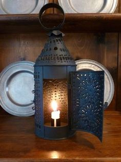 punched tin lantern                     **** Old Lanterns, Camping Lanterns, Camping Lights, Antique Pie Safe, Country Primitive, Primitive Decor, Primitive Lighting, Tin Ceiling Tiles, Mood Light