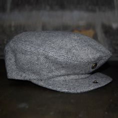 18 Waits | Jewelry & Accoutrements | Billy Cap | Light Grey Herringbone  $35  Billy Caps are hand-made in Montreal. Based on a vintage pattern and updated by 18 Waits. Wool is sourced from Woolrich Woolen Mills in Pennsylvania. This Fall/Winter we are offering three variations: charcoal herringbone, light grey herringbone, and brown plaid. Trimmed with a super-soft leather sweatband.