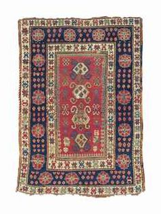 A KAZAK RUG -   SOUTH CAUCASUS, FIRST QUARTER 19TH CENTURY -   Corroded dark brown, areas of uneven wear, scattered repiling and repairs, minor loss to sides  6ft.10in. x 4ft.9in. (208cm. x 145cm.)