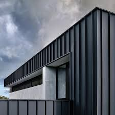 matte black colorbond - Google Search Roof Cladding, Cladding Design, Exterior Wall Cladding, Steel Cladding, Aluminium Cladding, House Cladding, House Siding, Facade House, Black House Exterior