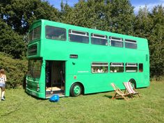 Bus converted into small home for family of three. With working shower/ toilet and three beds!