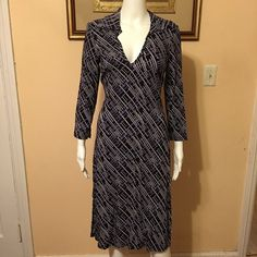 """Bebe Printed Dress Open for reasonable offer. The item you are about to purchase is a Bebe Printed Dress. Size small. There's a slit on each side. Super chic! To make an offer, please use """"offer"""" button. Thank you! bebe Dresses"""