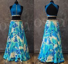 Summer Breeze This western style lengha comes with a tie-dyed skirt which has shades on blue and beige and a mirror work border. The top is done in a vibrant blue raw silk with a mirror work border, a front zipper and a keyhole in the back.the skirt tho
