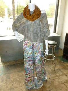 Print palazzo pant with Cable knit off the shoulder sweater!  Add one of our Shimmer & Bliss Scarves to complete your look!