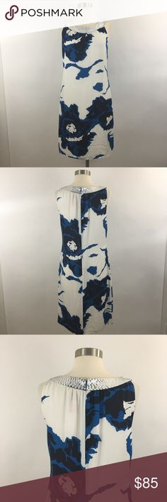 "Tory Burch Silk Printed Shift Dress Tory Burch Silk Printed Shift Dress Size 8 Sleeveless White Blue Abstract  Gently used condition, tag label coming loose from seam(as seen in last photo)  Measurements Taken Laying Flat.  Bust : 17""  Length : 37""  Waist : 16.5""  Please use the pictures as your best guide for the items description and condition. Lighting may change your perception of the actual color of the item. Pictures are of the actual item you will receive. If you have any questions do…"
