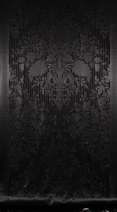 """These delicate cutwork screens are a celebration of the skill of the leather craftsman, combined with the latest laser cutting technology. Exquisite Baroque floral motif cutouts are inspired by the Italian Renaissance. Truly """"floor to wall couture."""" The tasseled leather fronds hang effortlessly at the bottom. This screen is a stunning addition to any wall or room."""