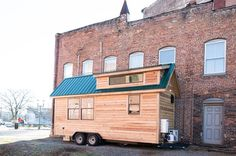 This is is the Lindley Tiny House by Tiny Life Construction. From the outside, you'll notice pine clapboards and a turquoise metal roof that has dormers for extra loft space. When you go insi…