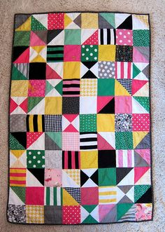 cute baby quilt idea with charm squares and hst and quarter square triangles... simple and fun!