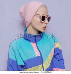 Tomboy blonde in fashionable hat beanie and pink glasses Vanilla vibration