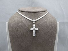 "The Latin style cross with CZs on a 16"" chain."