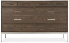 Our Alden dresser features sleek, modern design that will complement a variety of room styles. Handcrafted in a small woodworking shop in northern Wisconsin, each Alden dresser is made from domestically sourced solid ash and ash veneer and finished to highlight the unique patterns of the wood grain. The steel drawer pulls are notched for easy gripping, while drawer box dovetail joinery enhances Alden's durability and speaks to the time-honored craftsmanship of the piece. Alden's refined look…