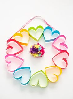 DIY Rainbow Paper Heart Pom Pom Wreath. Cute Valentine's Day Craft for Kids.