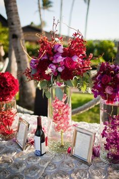 Tall Centerpiece with Orchids & Roses in Red, Purple & Pink