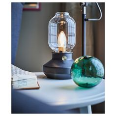 TÄRNABY Table lamp with LED bulb, anthracite. The visible light bulb emulates a live flame and you can adjust the brightness with the built-in dimmer. Small Lamps, Old Lamps, Unique Lamps, Black Table Lamps, Bedside Table Lamps, Lamp Table, Table Indus, Dimmable Light Bulbs, Glass