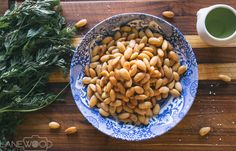 Lanewood Studio Food Photography. Delicious baked almonds with paprika on a blue, Spode dinner bowl.