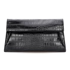 Croc-effect artificial leather is formed to a cute fold-over clutch with a hidden magnet closures. Top zipper opens to a fabric interior with side zipper pocket and slip pockets. Carry as a clutch, or attach the long strap. Look vampy in this sultry piece by pairing it with a slip dress, strappy heels, chandelier earrings and luscious red lippies.