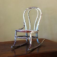 antique rocking chair - nice multi coloured distressing