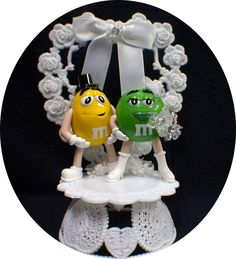 Wedding Cake topper with Cute Mr Yellow and Mrs Green MM figure M&M candy funny by YourCakeTopper on Etsy https://www.etsy.com/listing/198938981/wedding-cake-topper-with-cute-mr-yellow