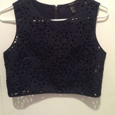 Thanksgiving Sale! Cut Out pattern tank top Navy Blue tank top with cut out flower detail from Forever 21. Worn once! Forever 21 Tops Tank Tops