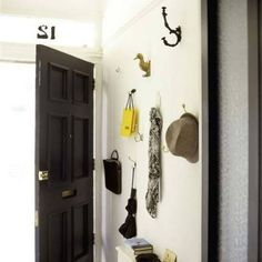 Instead a coat rack, put up an assortment of coat hooks. We love this whimsical mix of vintage coat hooks with the run-of-the-mill kind to make this entryway unique even when its not covered in coats and jackets. Apartment Entryway, Apartment Living, Apartment Therapy, Apartment Design, Apartment Ideas, Interior Exterior, Interior Paint, Interior Doors, Interior Design