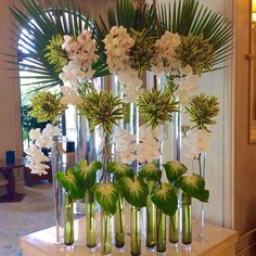LOBBY LOVE FOUR SEASONS // a modern tropical display of white cymbidium, white phaleo, obake anthurium and tropical leaves at the Hotel Flower Arrangements, Flower Arrangement Designs, Wedding Arrangements, Tropical Flowers, Tropical Leaves, Tropical Plants, Cactus Flower, Exotic Flowers, Beautiful Flowers