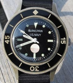 Blancpain U.S. Navy.. fyi that paper circle in the middle is actually like litmus paper to tell the service man whether the watch as been breached by water.