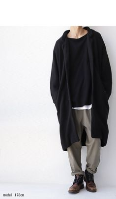 Long black cardigan, black loose shirt, white rounded tank underneath, rolled up colored loose pants (sort of olive-khaki)