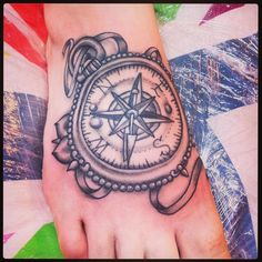 Black and grey compass tattoo.