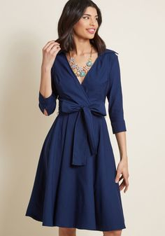 The timeless aesthetic of this navy wrap dress broadcasts your put-together persona for all to appreciate! Between its classic collar, cropped sleeves with...