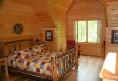 Loft Bedroom With Natural Log Bed In A Golden Eagle Log Home