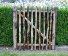 Easy Pieces: Wooden Garden Gates - Gardenista The perfect rustic gate for my rustic-meets-city backyard.The perfect rustic gate for my rustic-meets-city backyard. Wooden Garden Gate, Garden Gates And Fencing, Wooden Gates, Fence Gate, Fences, Picket Gate, Cedar Fence, Rustic Gardens, Outdoor Gardens