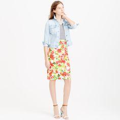 "We gave a classic pencil skirt a slightly longer length and a bright tropical floral from an Italian print house that's famous for its one-of-a-kind designs. The result is the kind of skirt that puts us in the mood to salsa and sip sangria on vacation, but it'll also brighten up a button-down at the office. <ul><li>Sits above waist.</li><li>26 1/2"" long.</li><li>Falls below knee.</li><li>Cotton.</li><li>Back zip.</li><li>Lined.</li><li>Dry clean.</li><li>Import.</li></ul>"