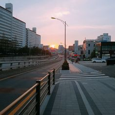 City street by buildings against sky Aesthetic Korea, City Aesthetic, Building Aesthetic, Sunset Wallpaper, Imagines, Street Photo, City Streets, Aesthetic Pictures, Scenery