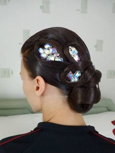 Low bun with loops and rhinestone accents. Great hairstyle for latin and standard ballroom. Visit http://ballroomguide.com/comp/hair_make_up.html for more hair and makeup info